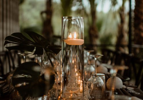 centerpiece with monstera and candles