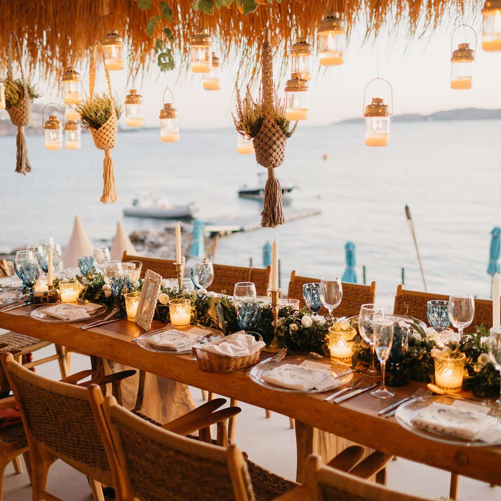 tablescape with hanging lanterns and votives