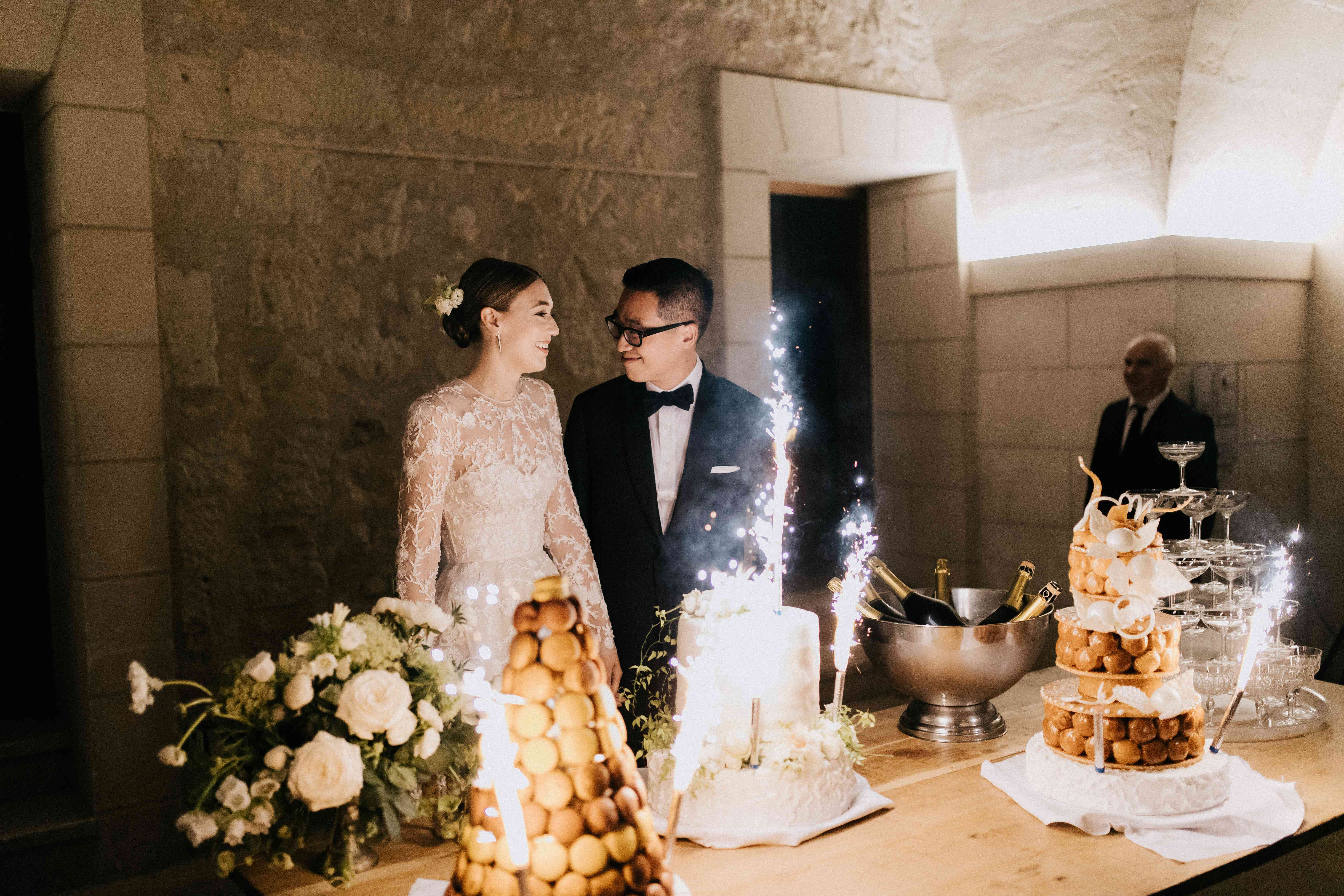 <p>macaroon tower sparklers on cake</p><br><br>
