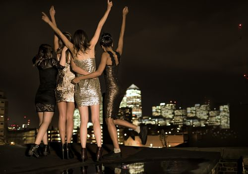 Women on rooftop celebrating