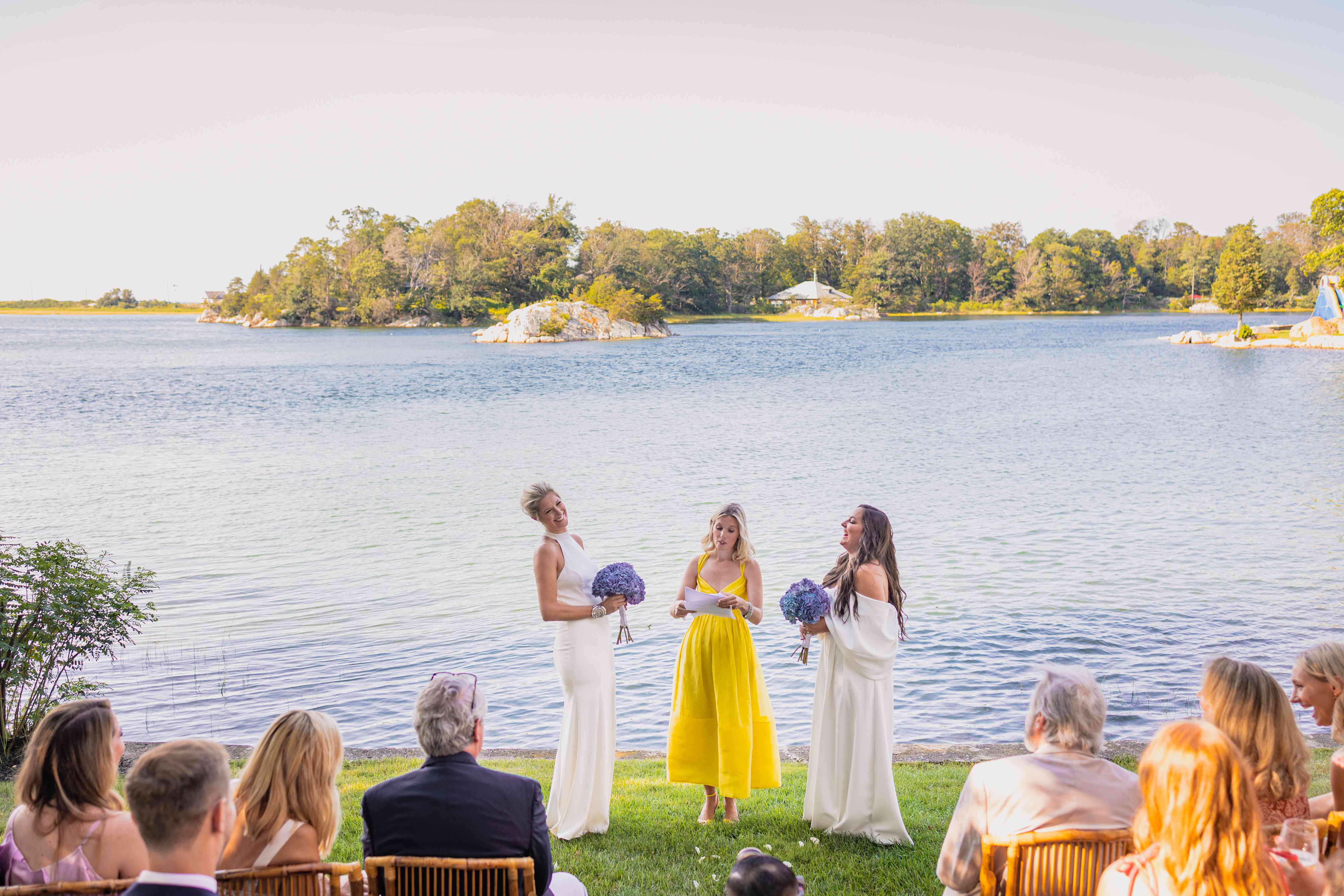 brides at ceremony on lake
