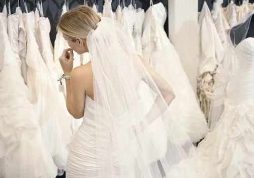 Woman looking at wedding dresses