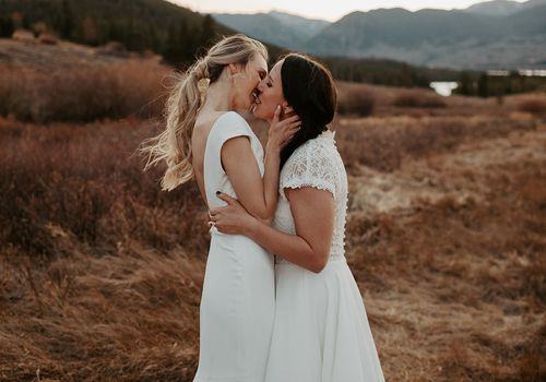 The two brides kiss after the ceremony