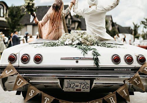 Newlyweds in getaway car