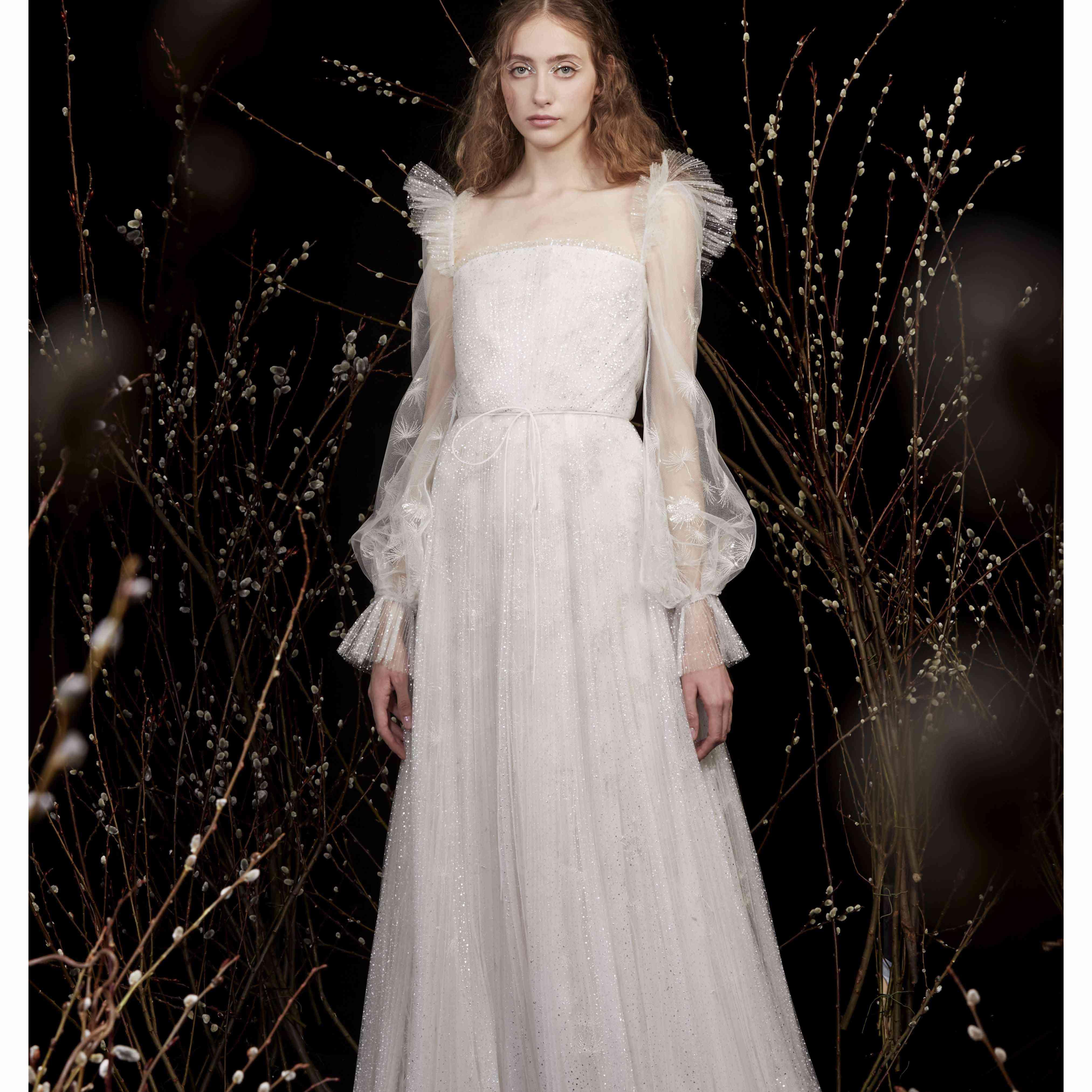 Model in long sleeve A-line wedding dress