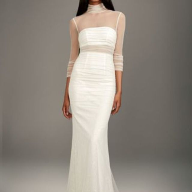 Model in wedding gown with illusion sleeves and bodice