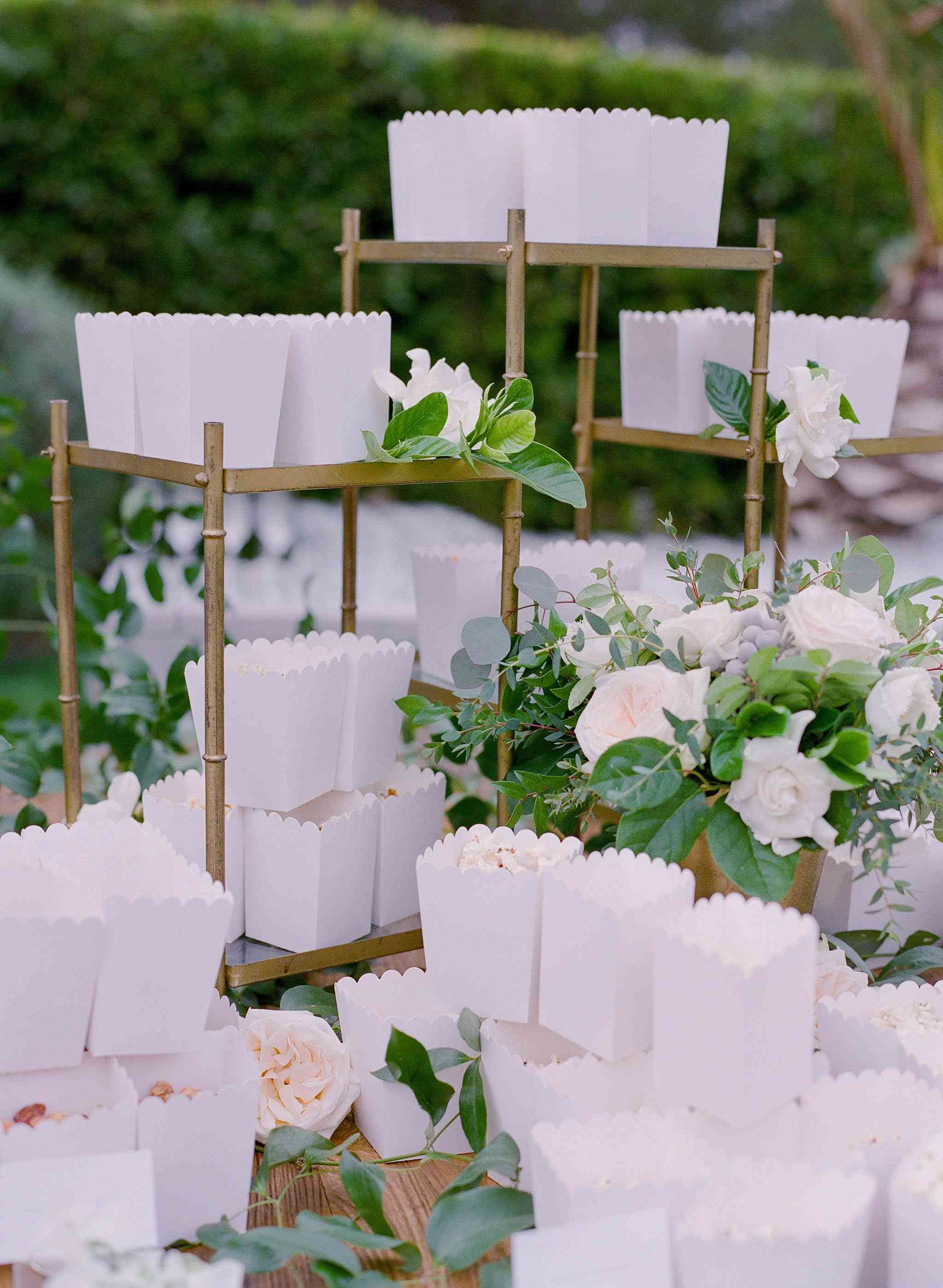 Display with white containers of popcorn decorated with pastel flowers