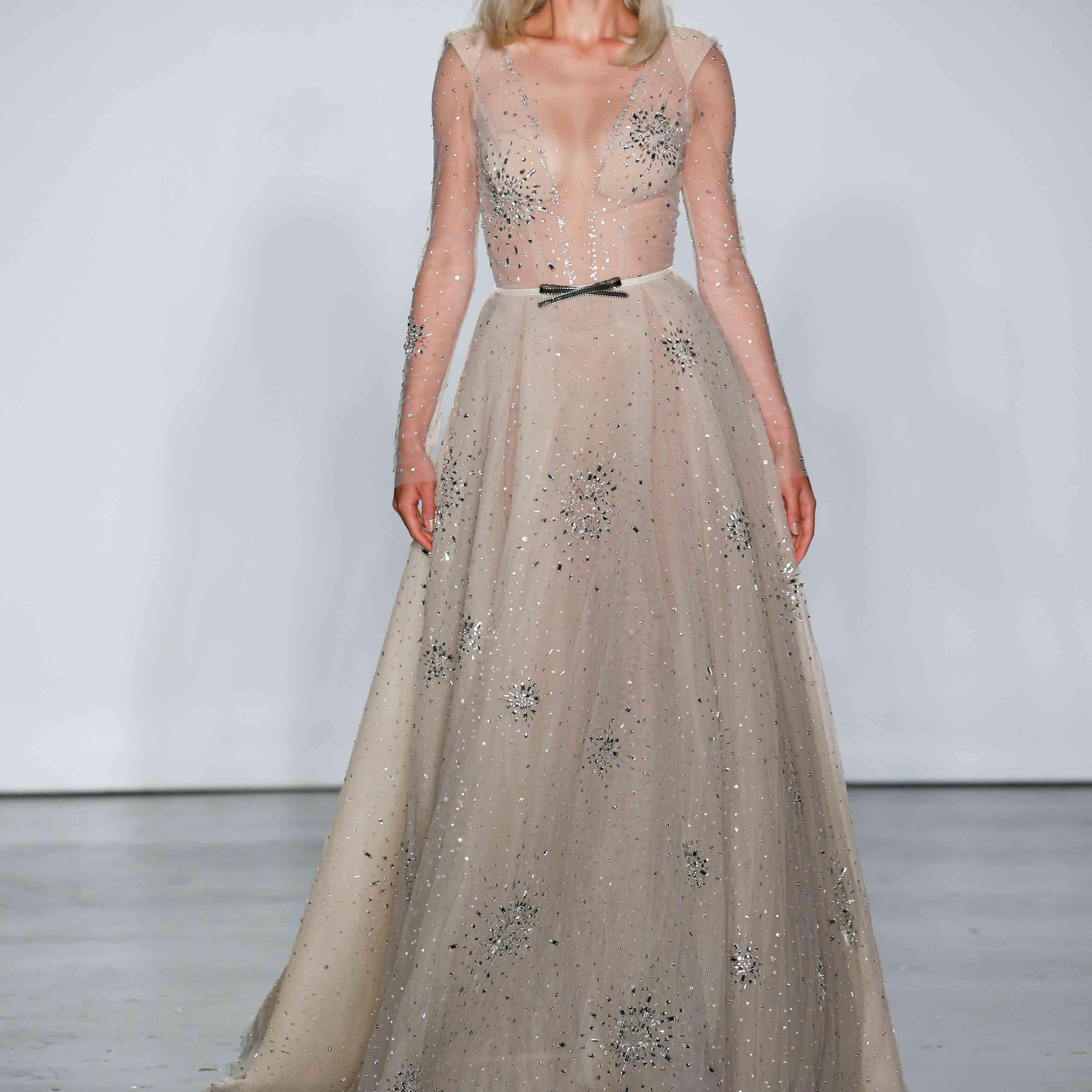 Model in long sleeve wedding ball gown