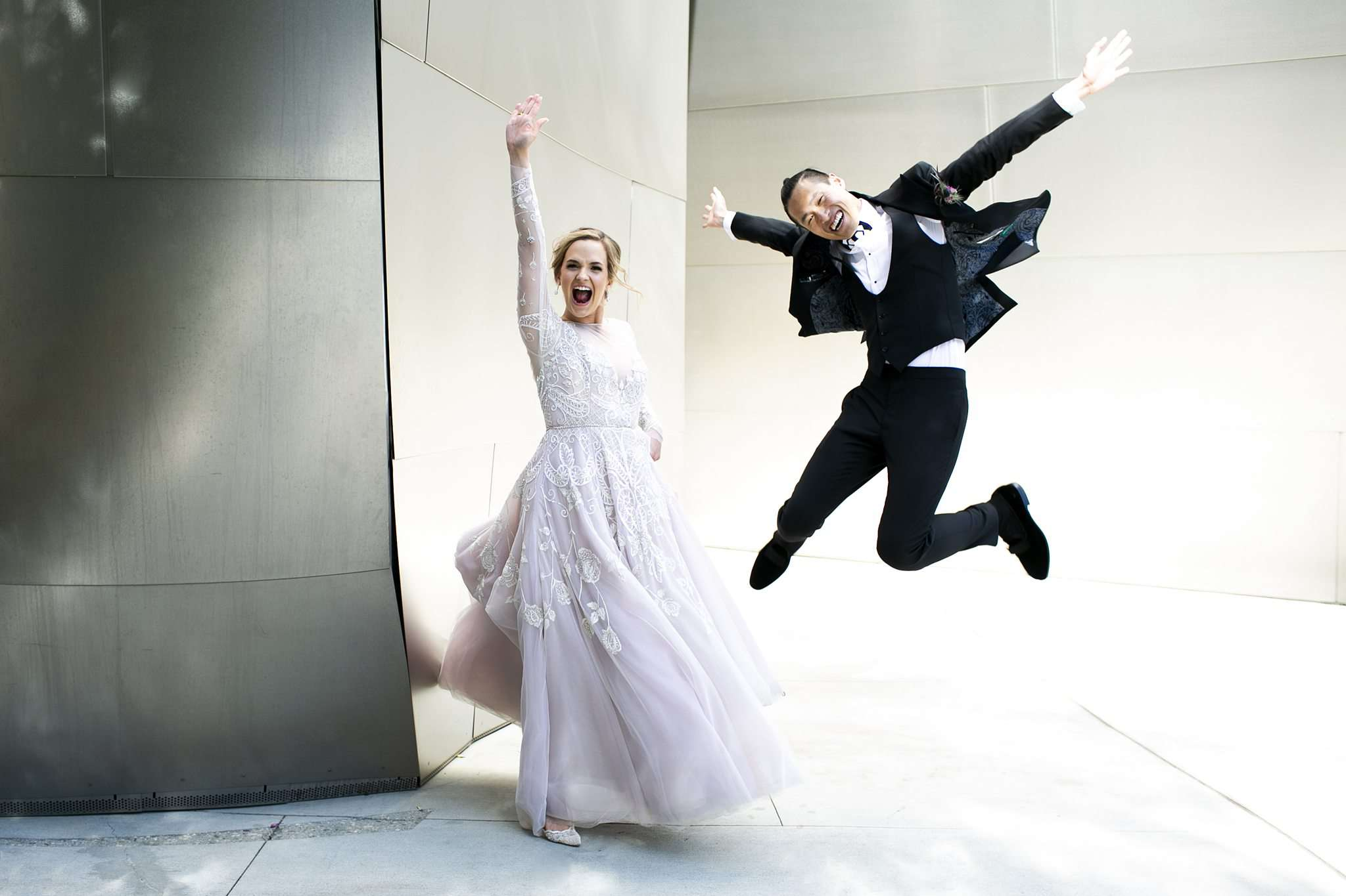 bride and groom jumping