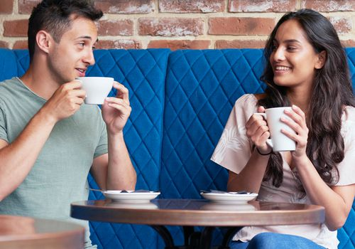 A man and a woman on on a coffee date