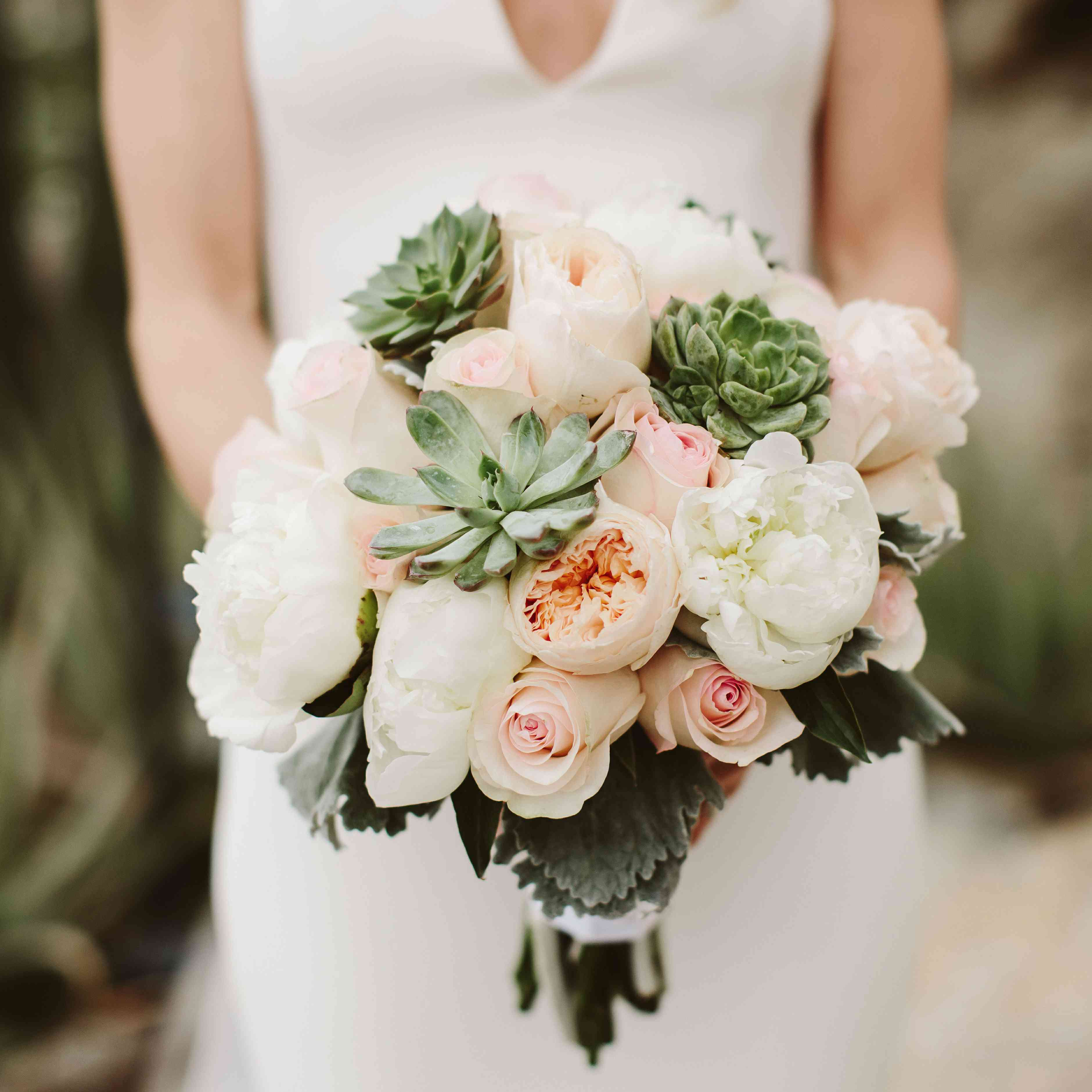 Light pink, white, and peach bouquet with succulents
