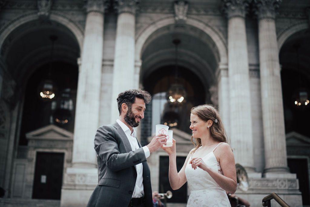 bride and groom holding beers