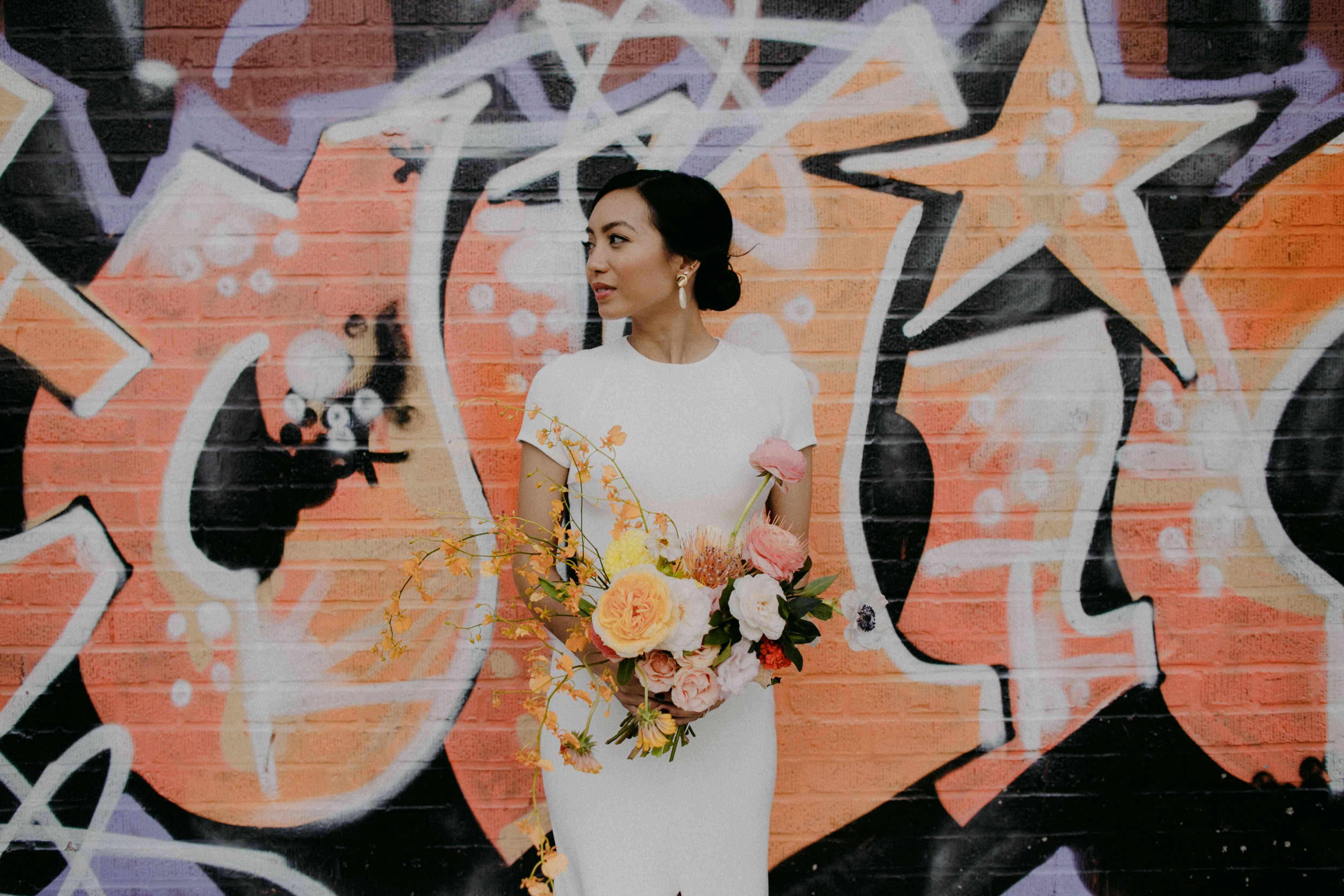 Bridal portrait in front of graffiti wall