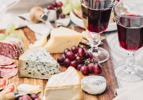 Cheese board and glasses of wine