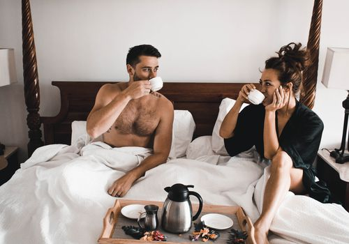 couple in bed with room service