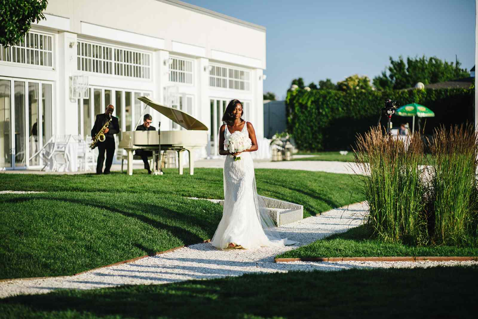 bride walking down the aisle at wedding ceremony