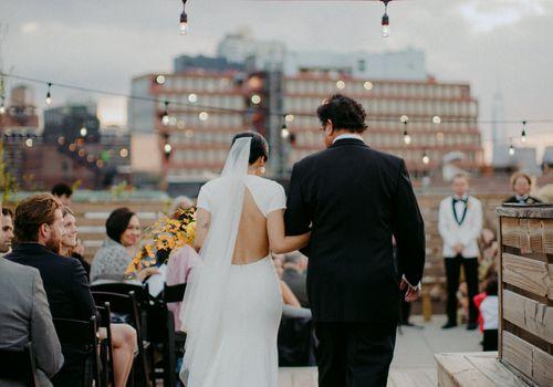 <p>bride walking down aisle</p>