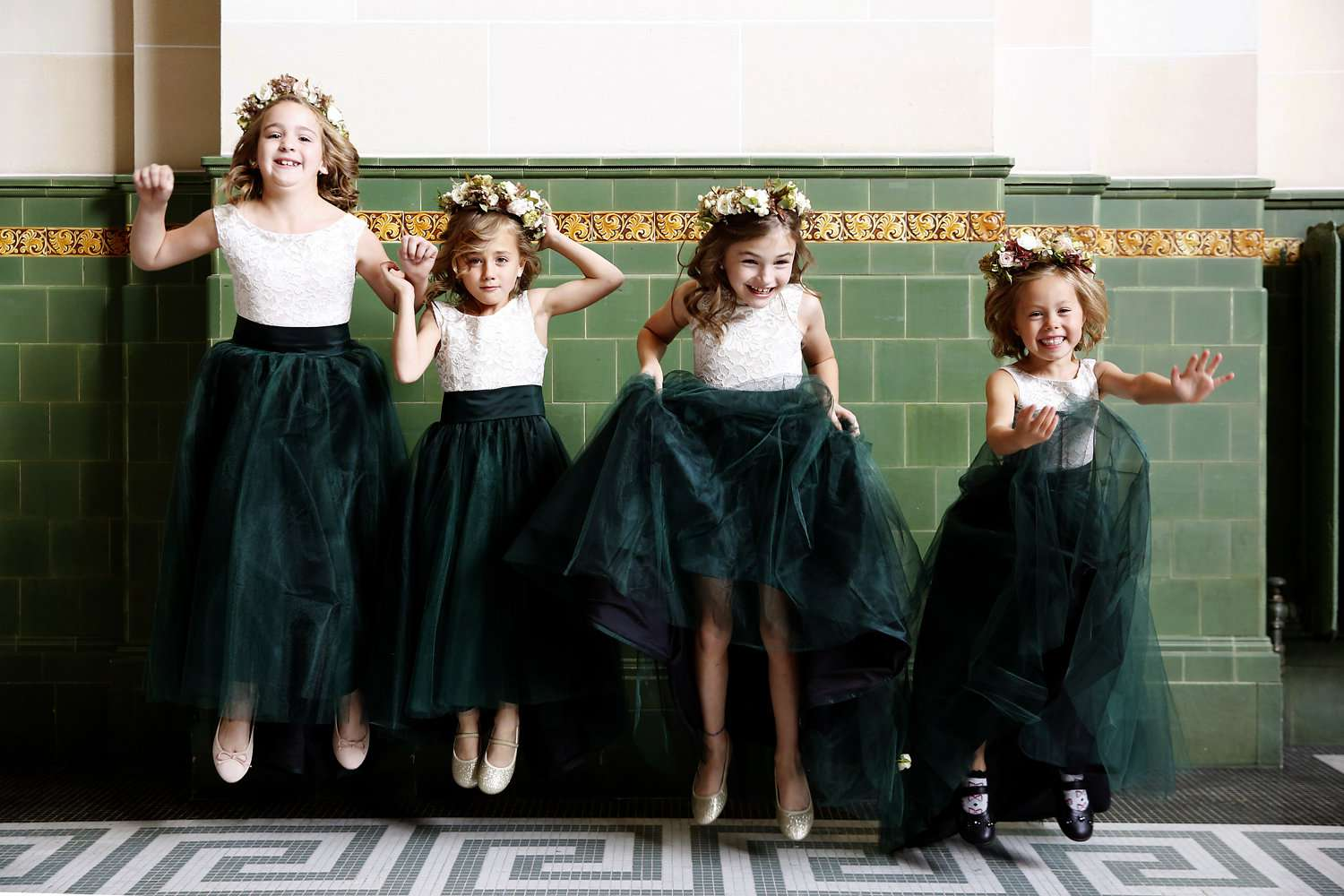 <p>flower girls in flower crowns and tulle green skirts</p><br><br>