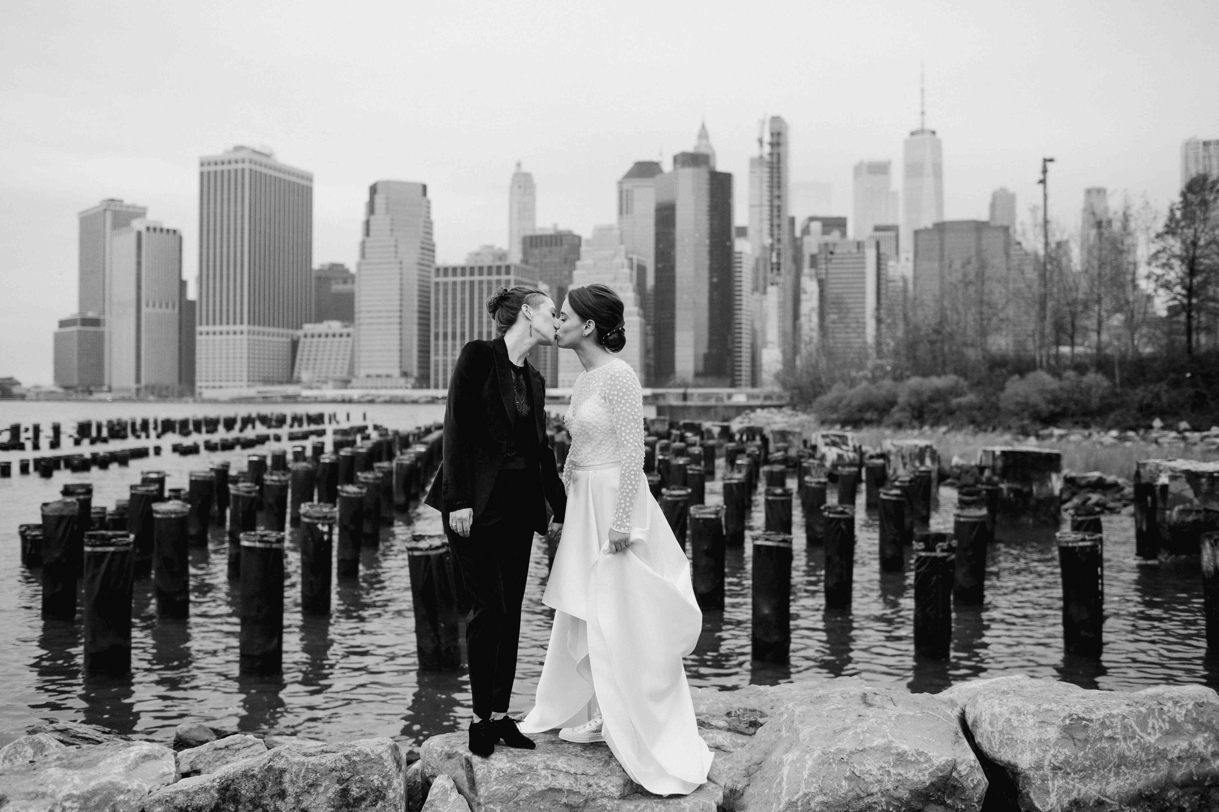 The couple share a kiss along the water