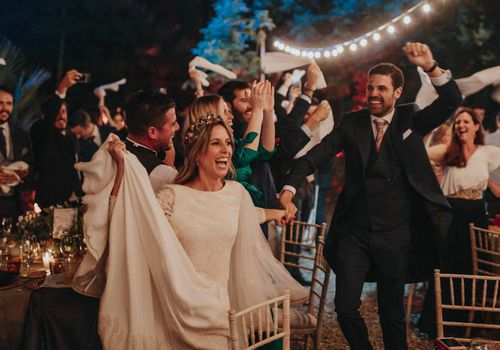 <p><p><p><p><p>Bride and guests dancing at reception</p></p></p></p></p>