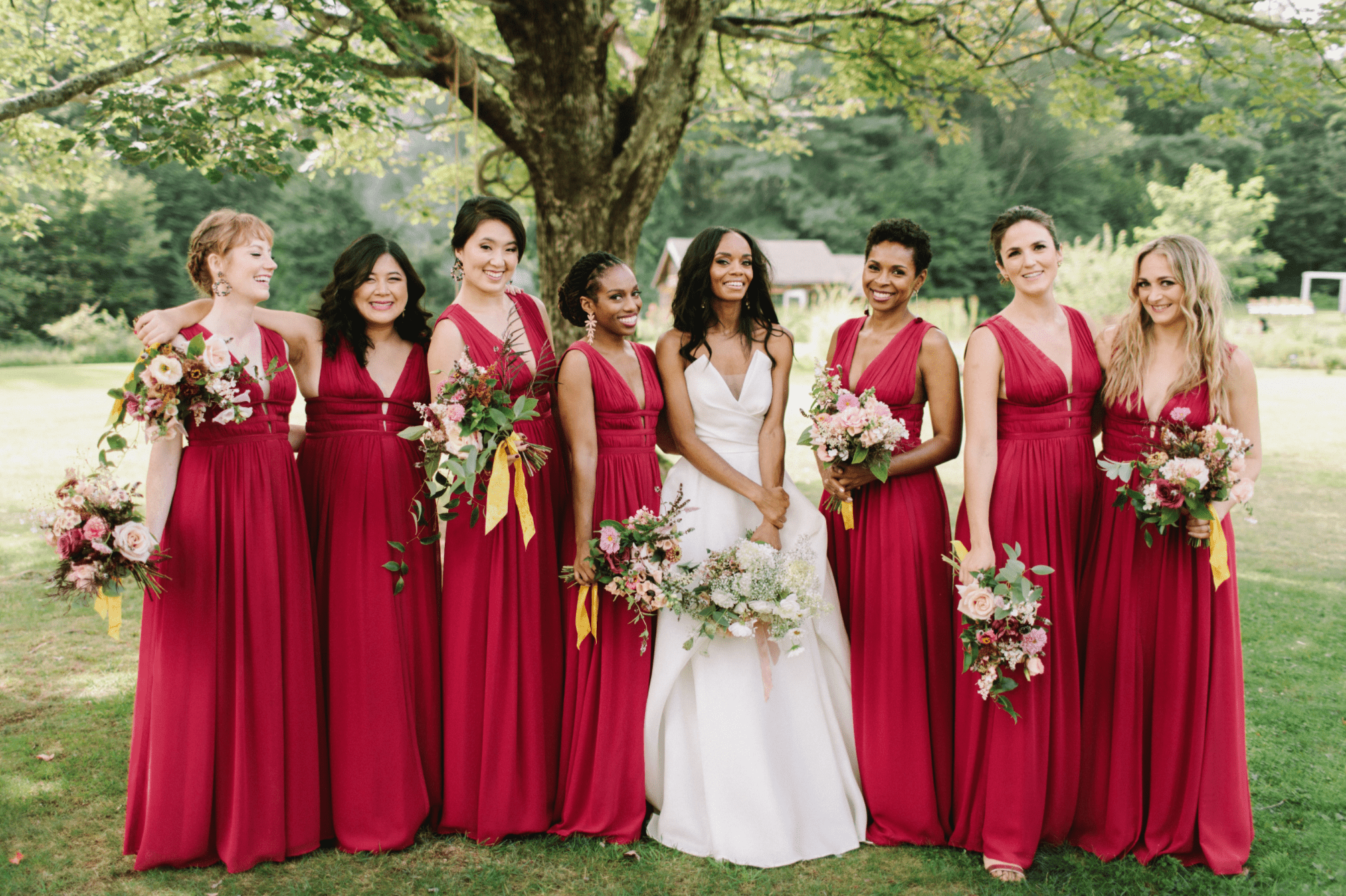 Bride with bridesmaids in red dreses