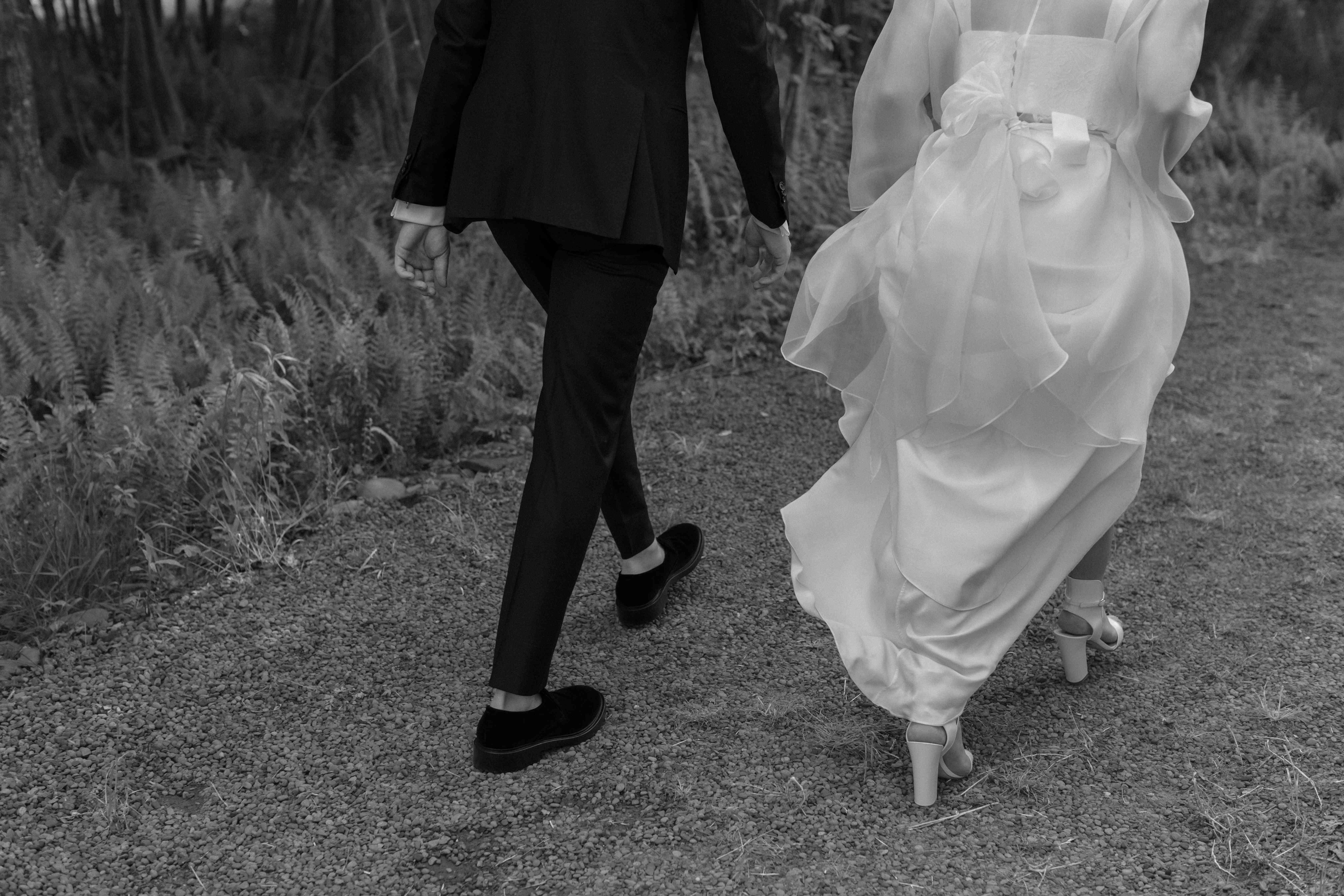 Bride and groom walking shot of feet