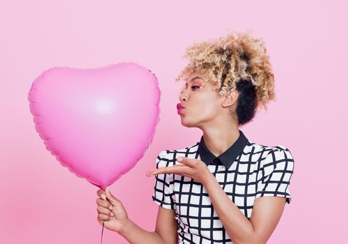 <p>Woman with Pink Heart Balloon</p>
