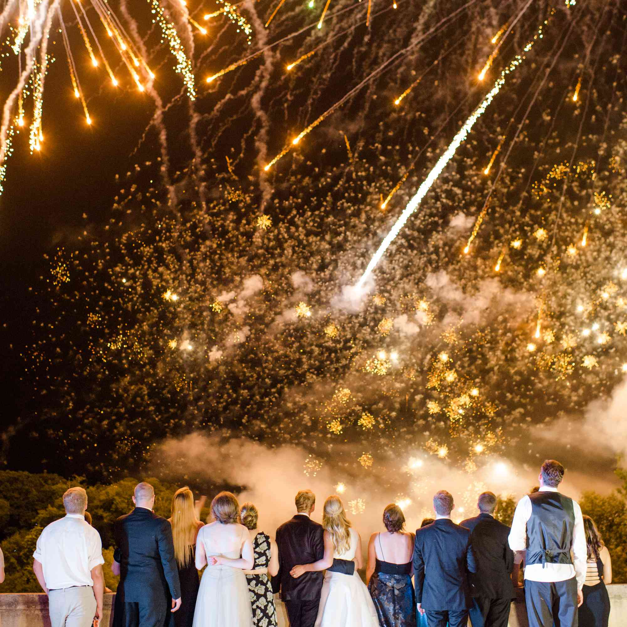 Wedding guests watching fireworks