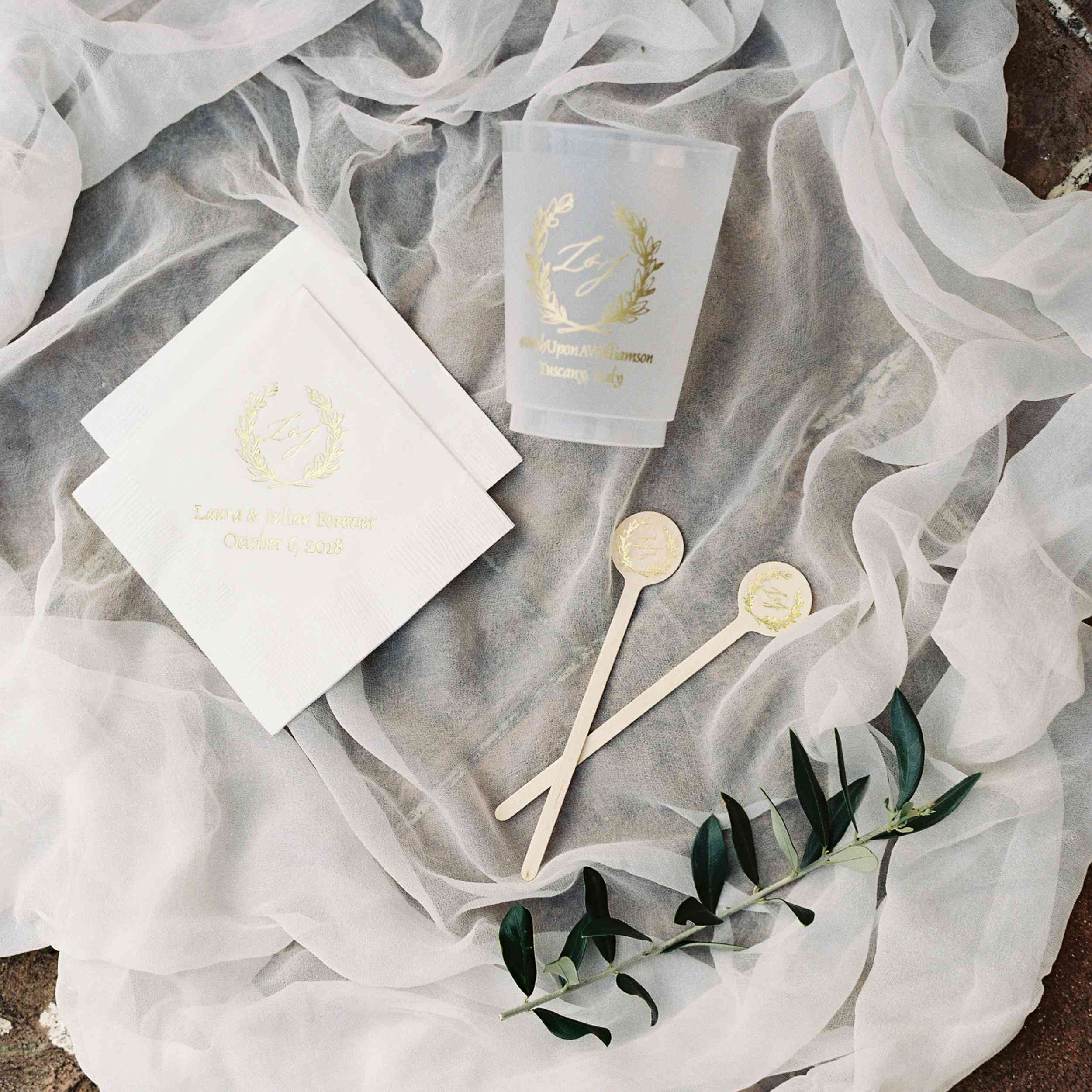 personalized napkins and cups on a veil