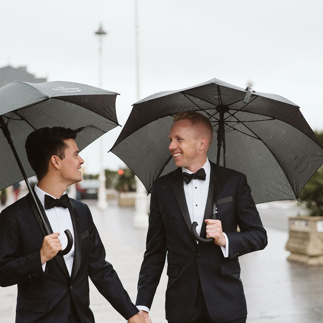 Grooms hold hands