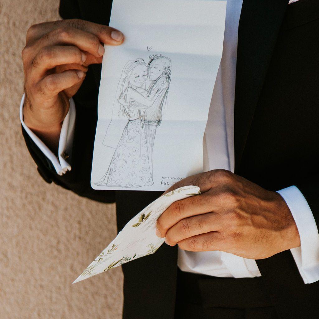 groom holding sketch