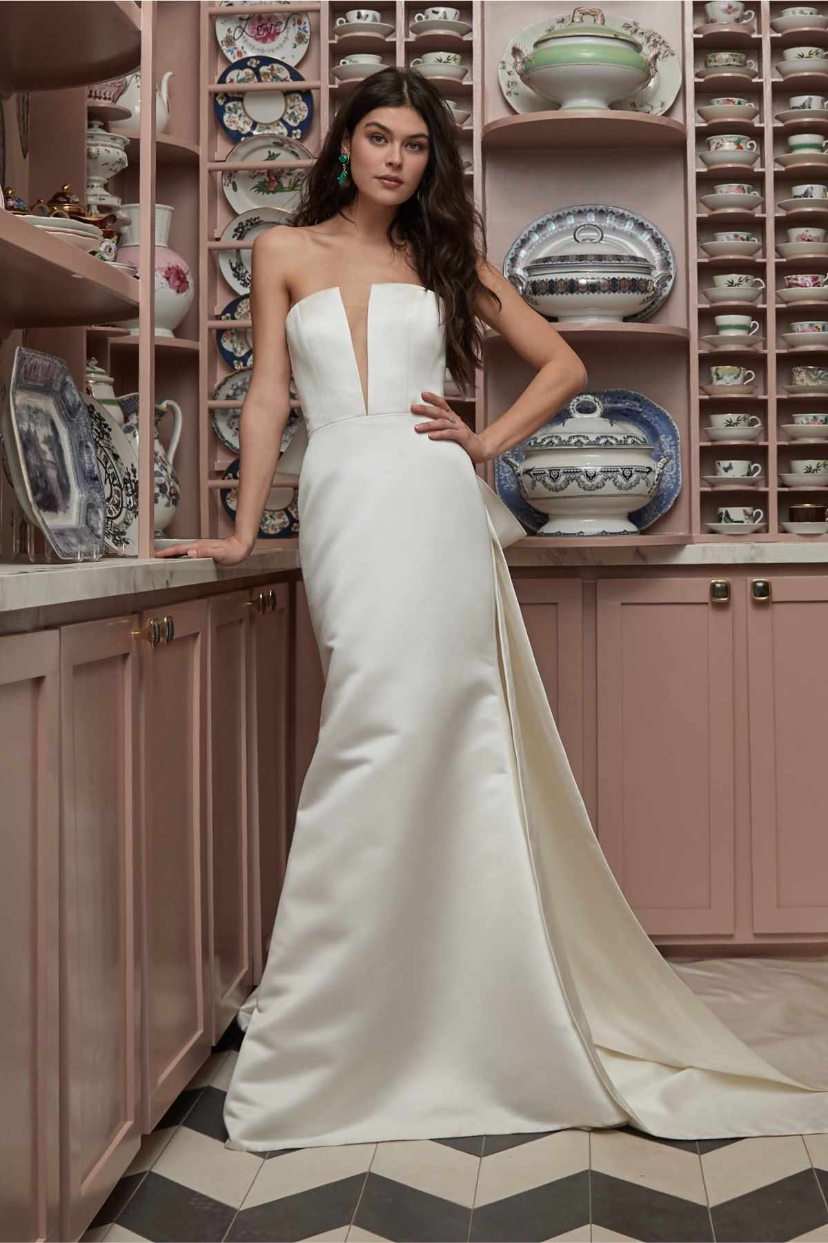 Model in a strapless satin fit-and-flare gown with a deep V illusion neckline