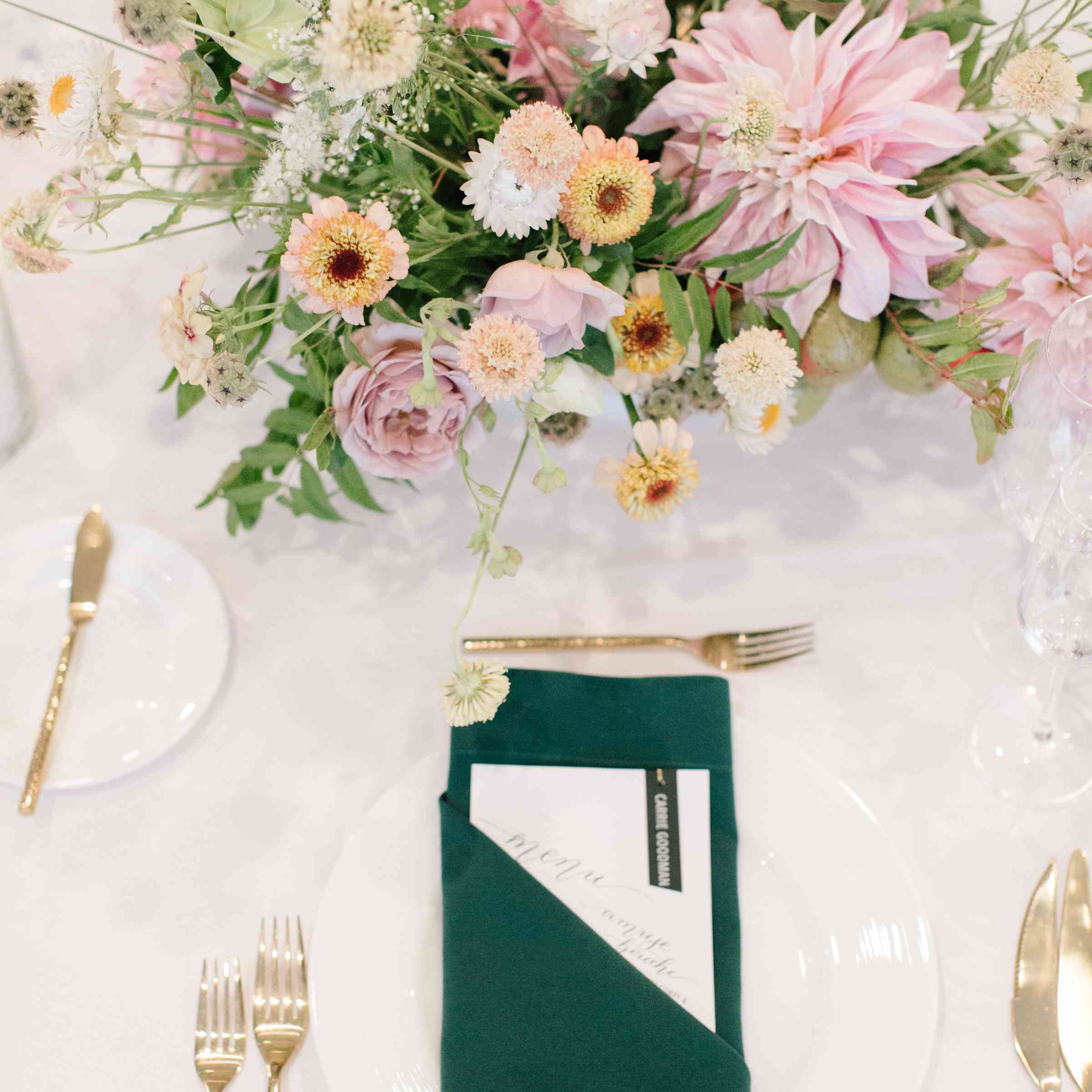<p>gold and green place setting</p>