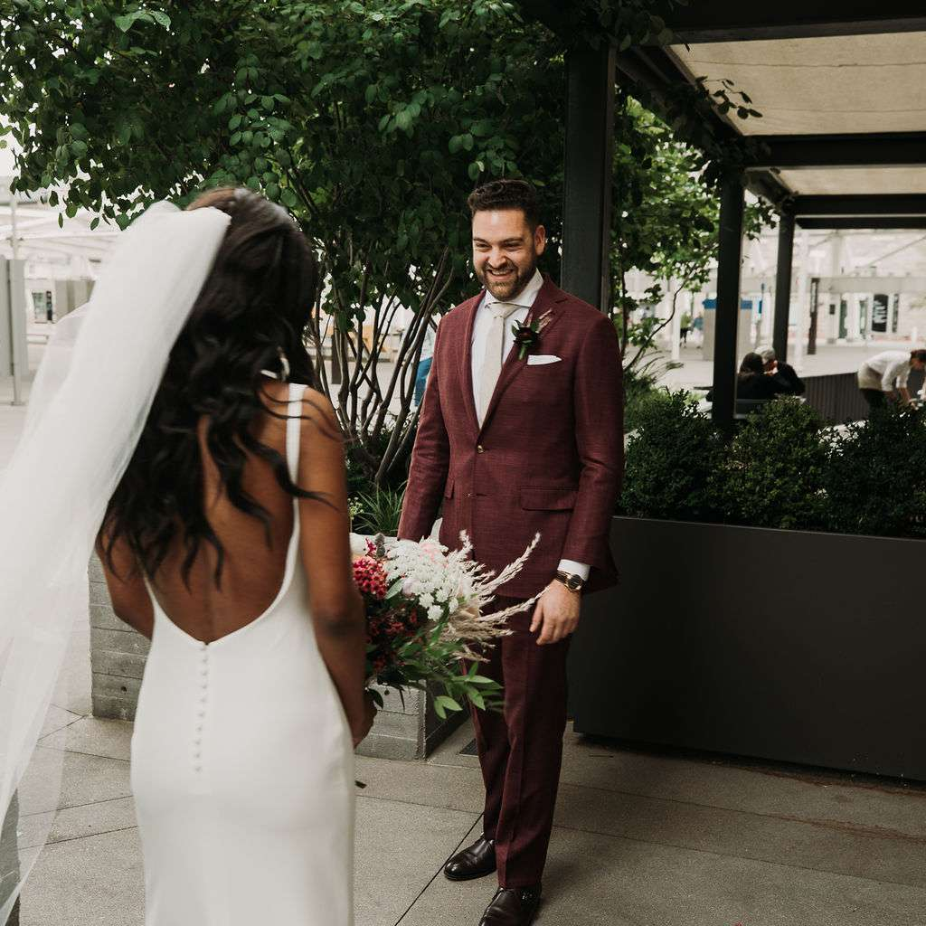 The bride and groom have their first look