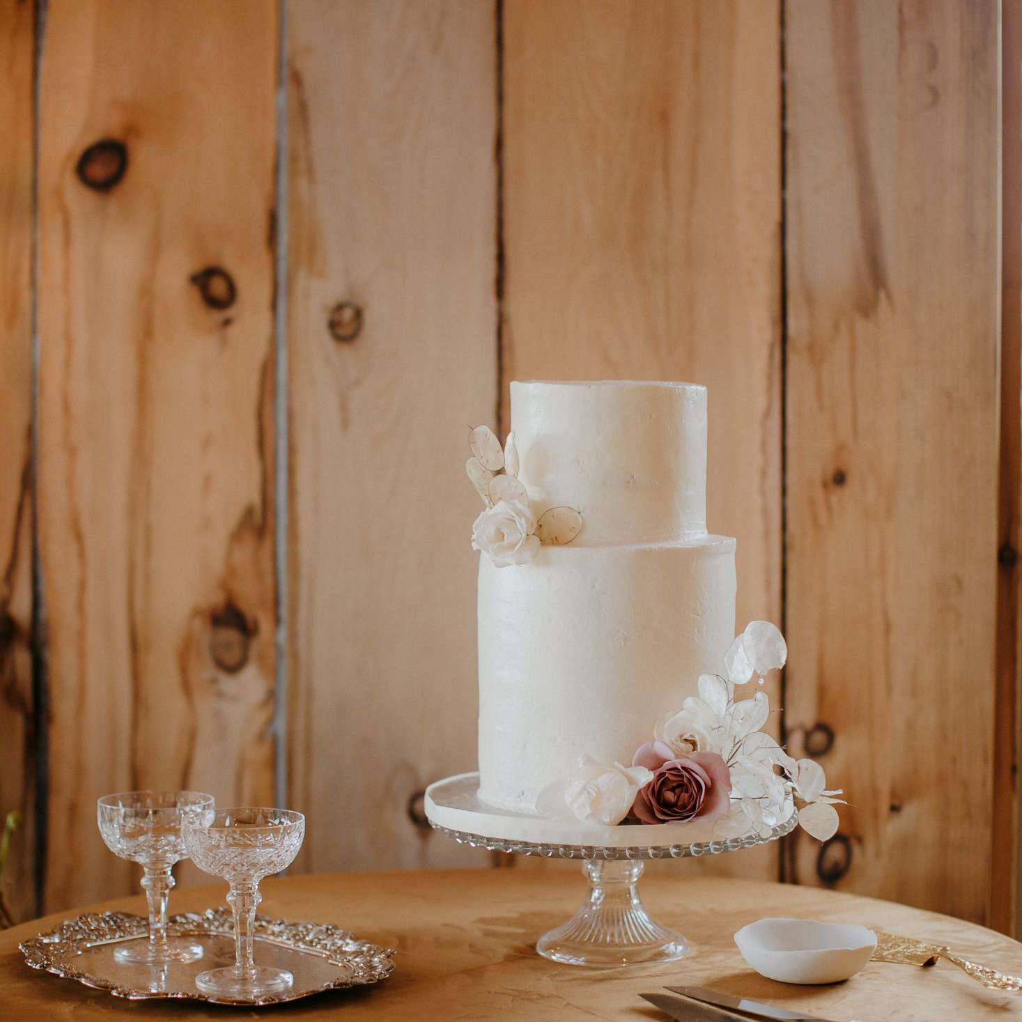 white two tiered cake with flowers
