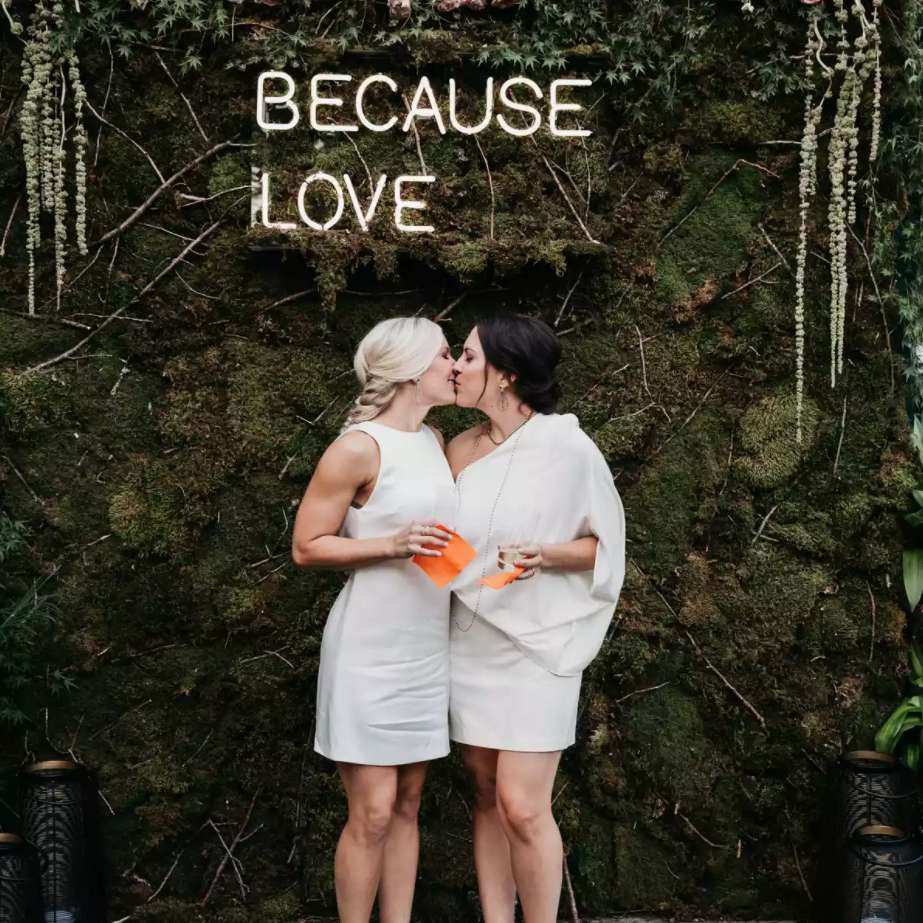 Brides kissing in front of