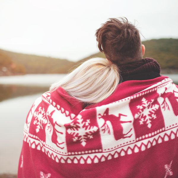 Couple Outdoors Under a Christmas Blanket