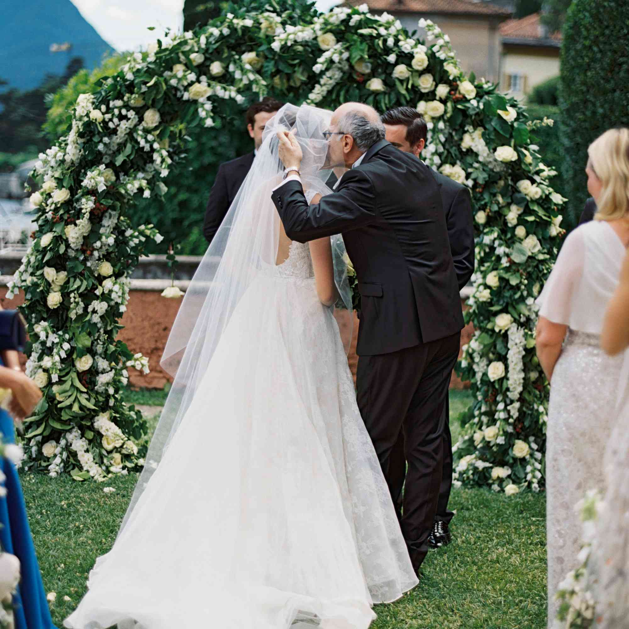 Father kissing bride's cheek