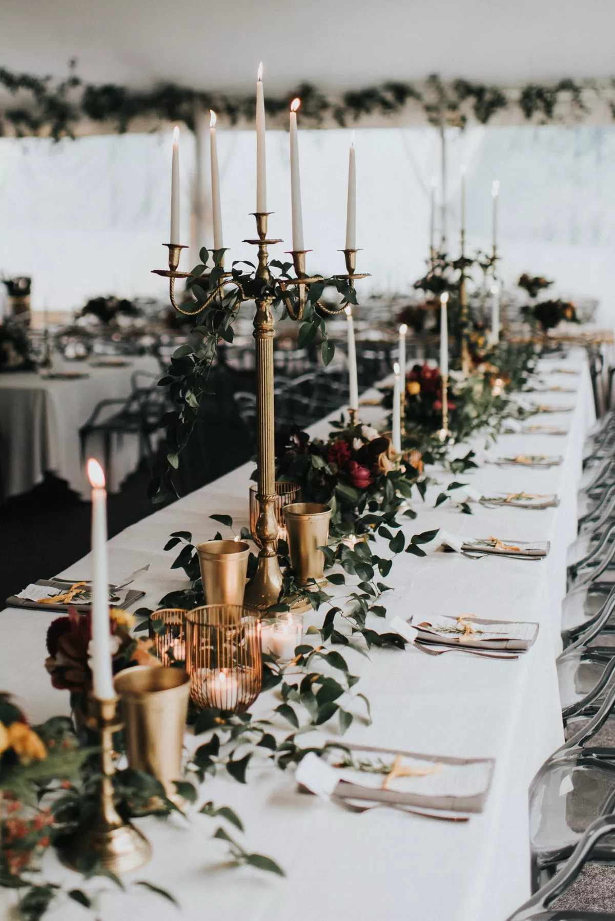 Candlelit reception space featuring dreamy tablescape