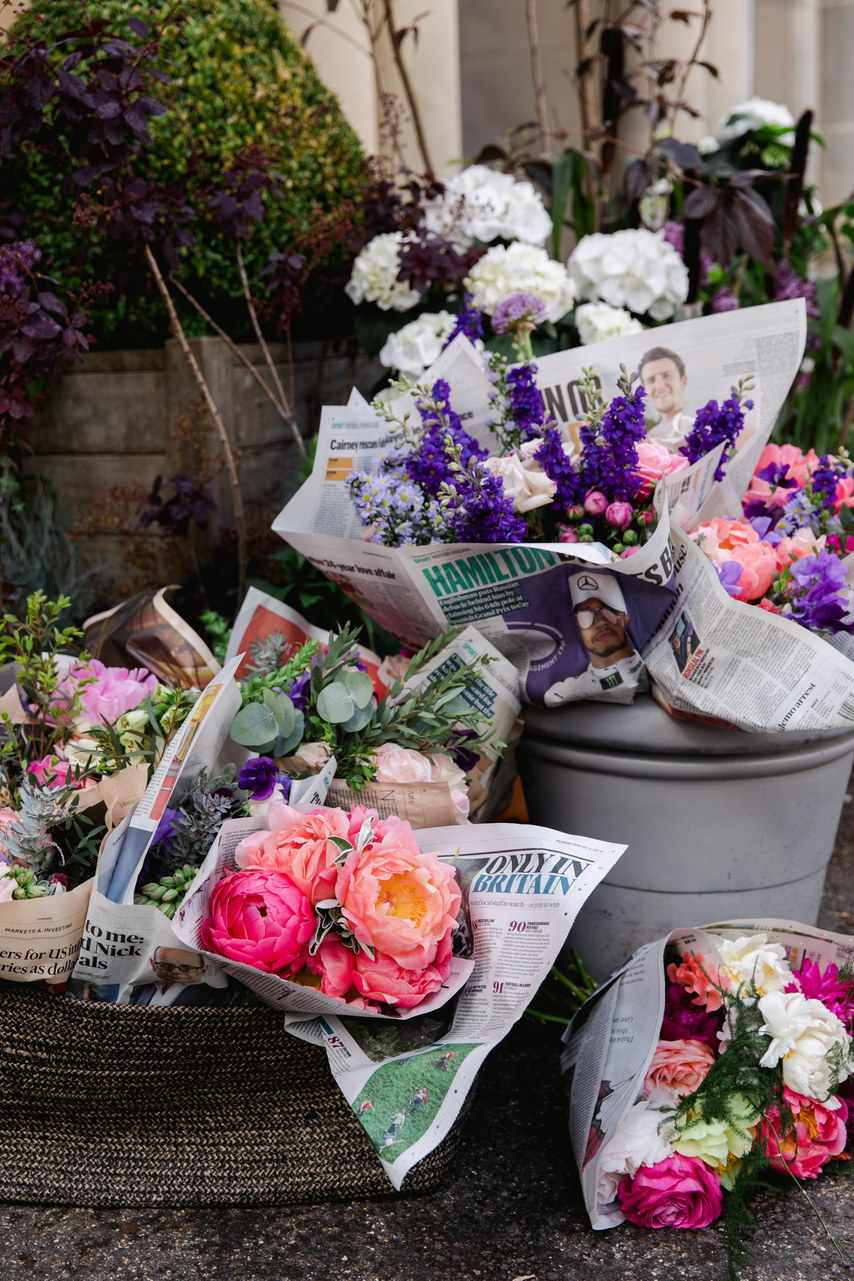 Wedding bouquets wrapped in newspaper