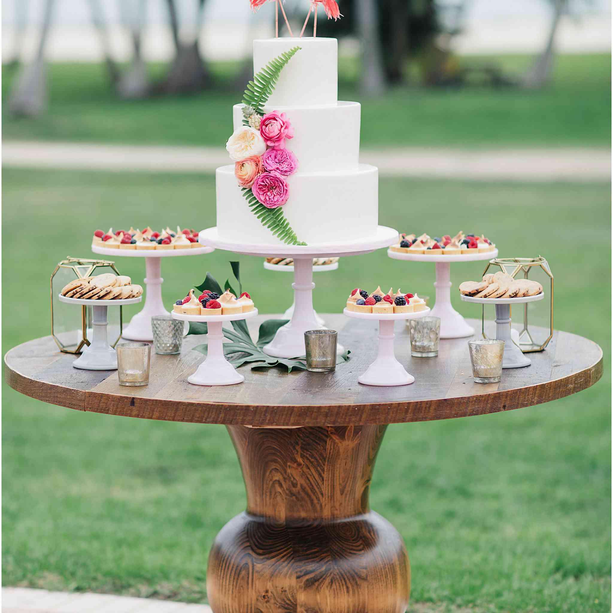 White Wedding Cake with Flamingo Cake Topper