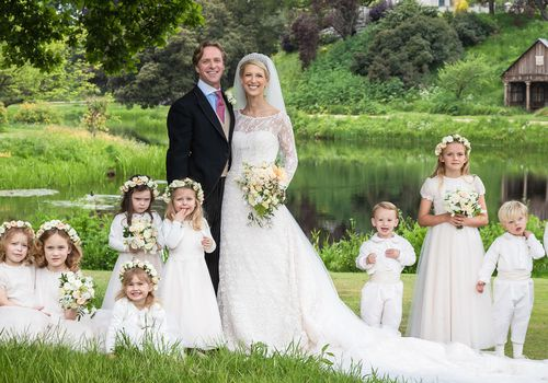 Lady Gabriella Windsor and Thomas Kingston in wedding attire beside eight children in white