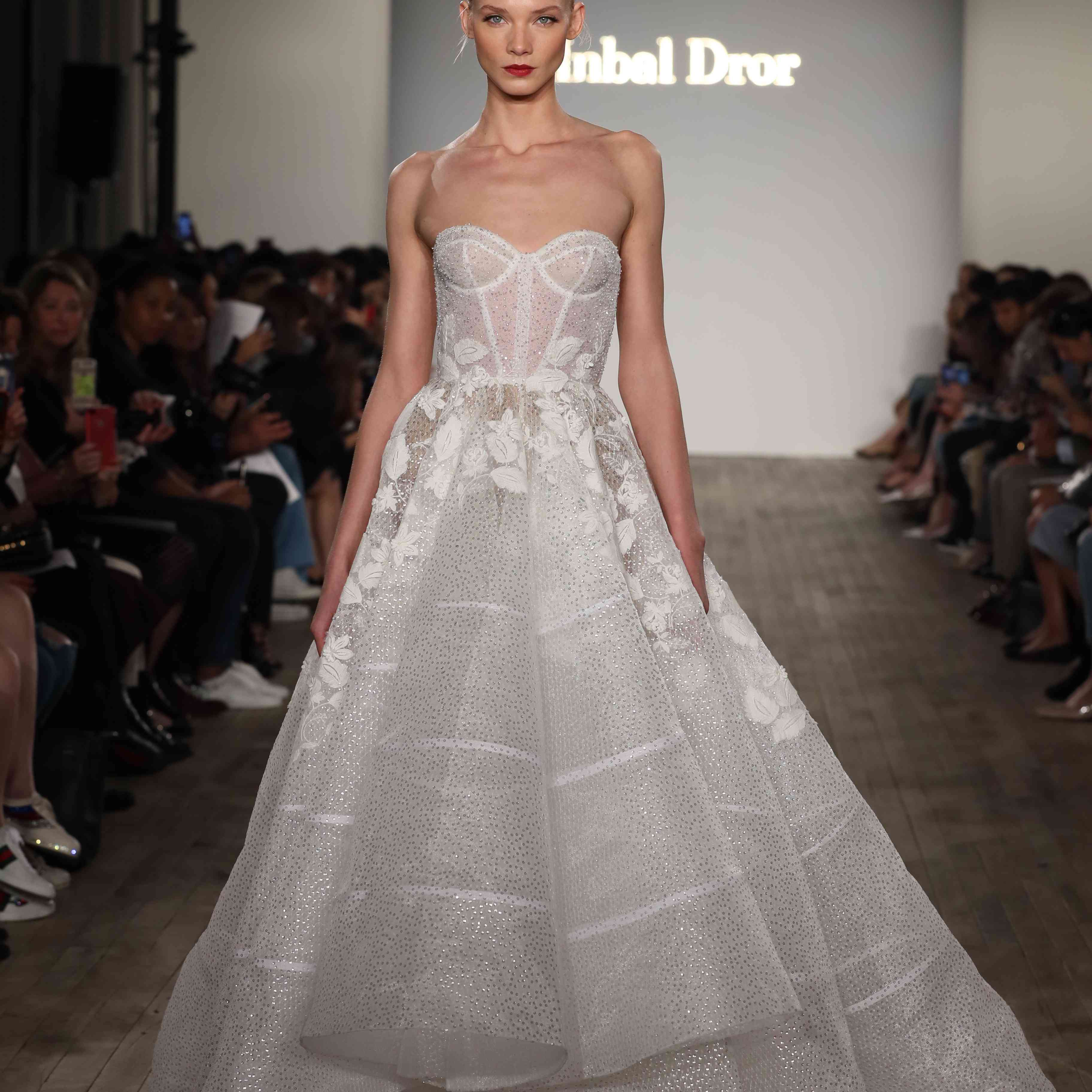 Model in strapless high-low wedding ball gown