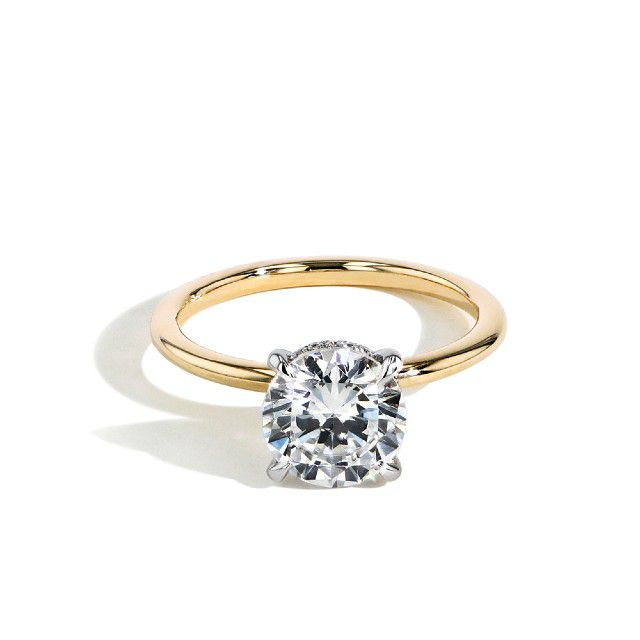 hidden halo engagement ring with gold band