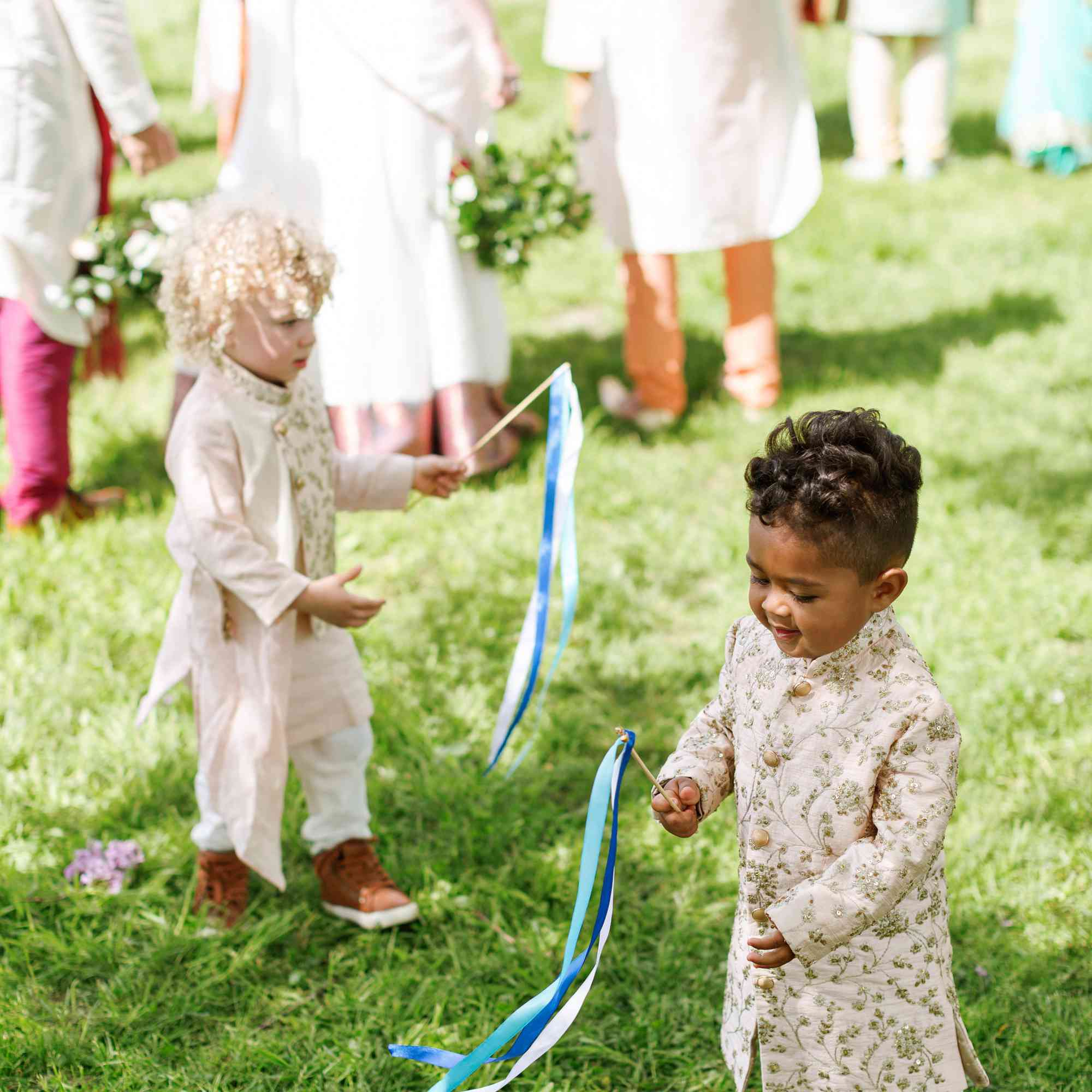 Ring bearers playing with streamers