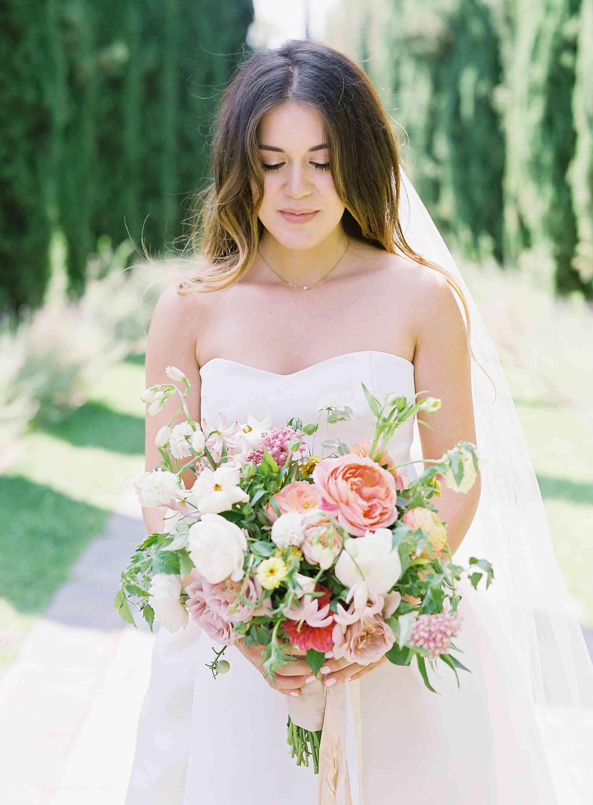 Bride with garden wedding bouquet