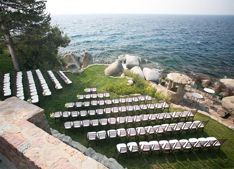 Asymmetrical ceremony seats water's edge