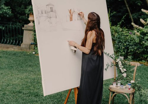 An artist painting outside.