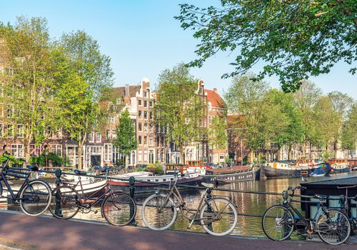 Bicycles on a bridge in Amsterdam in front of the Waalseilandgracht canal