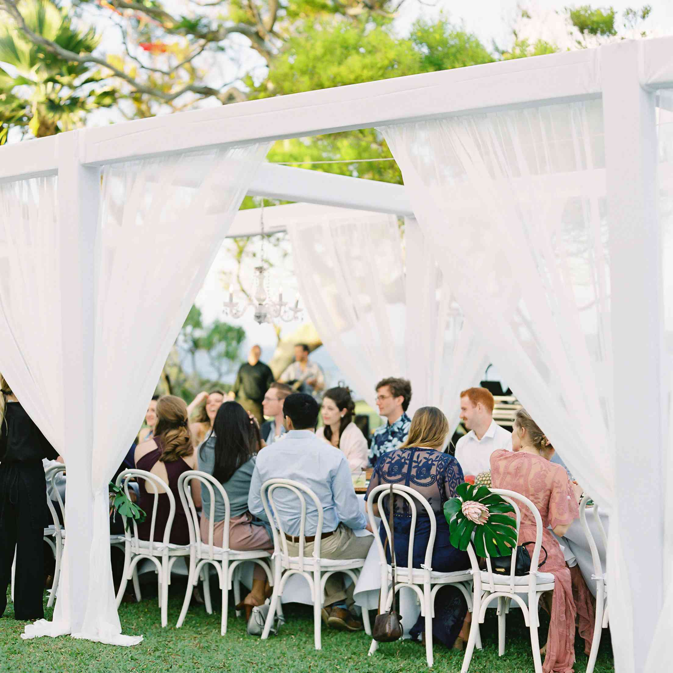 Intimate wedding reception table with white draping